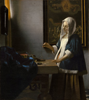 vermeer-woman-holding-a-balance